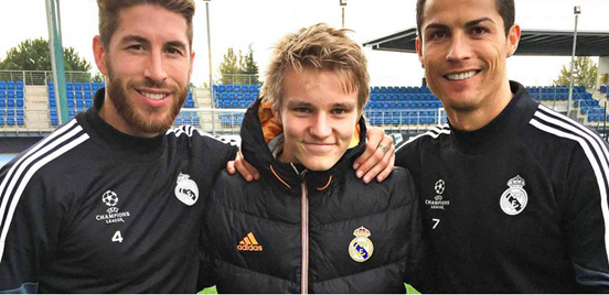 Martin Ødegaard (middle) poses for a picture with Sergio Ramos and Cristiano Ronaldo, his new teammates at Real Madrid.