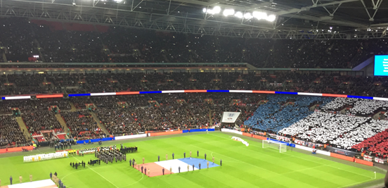 Both sets of fans sung the French national anthem, La Marseillaise, and a giant version of the French flag was displayed by England supporters on one side of the stadium.