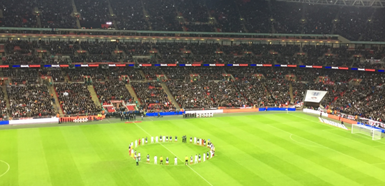 The players stood together around the centre circle during the minute's silence which was held in respect for the victims of the terror attack on Paris.