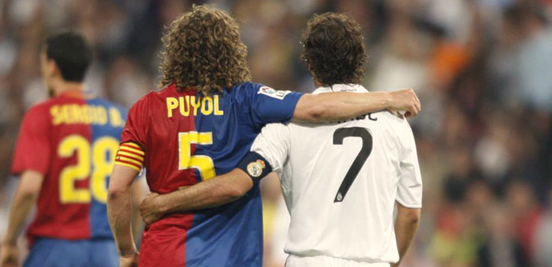 Carles Puyol and Raúl, two of the most iconic faces of Barça and Madrid in their long and colourful histories, showing some slightly surprising unity during a Clásico.