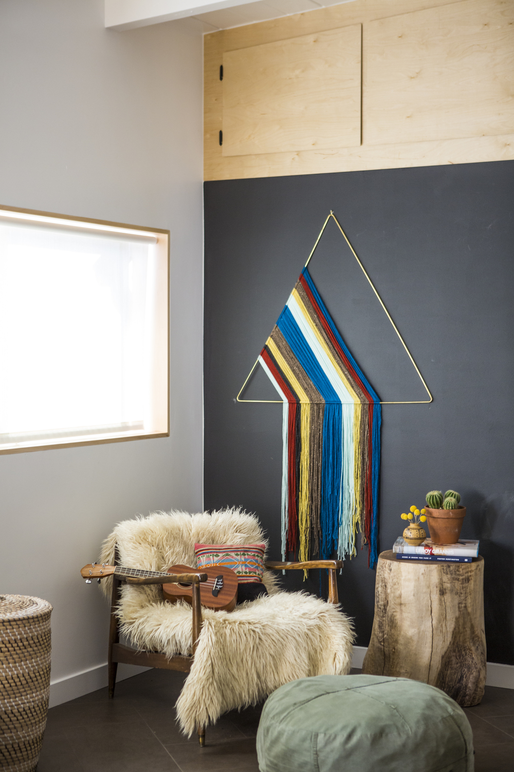 Brass Triangle + Custom Cabinetry + Wood Stump | Photo: Laure Joliet