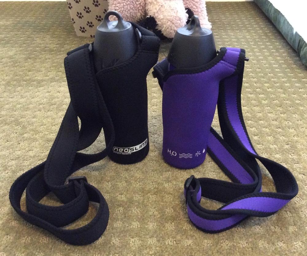 H20K9 Dog Water Bottles in their NEOSLING holders