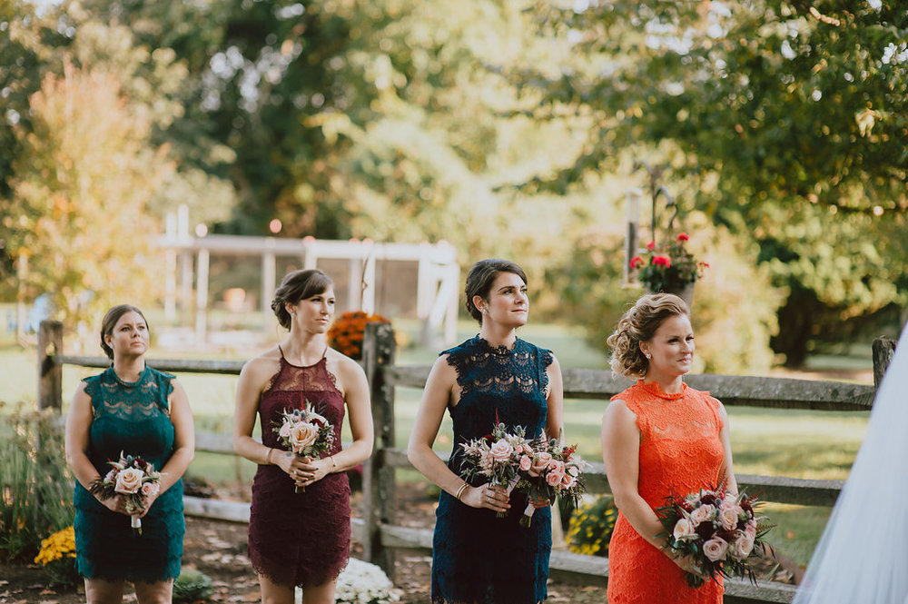 Private home wedding ceremony in West Chester, Pennsylvania with mix match bridesmaid dresses in fall palette :: wedding planner: Heart & Dash :: Pat Robinson Photography