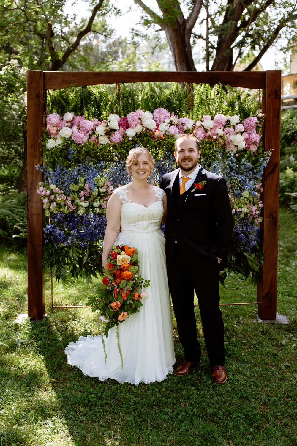 Amazing floral wedding ceremony backdrop at Arboretum wedding in June by Philadelphia wedding planner Heart & Dash-221.jpg