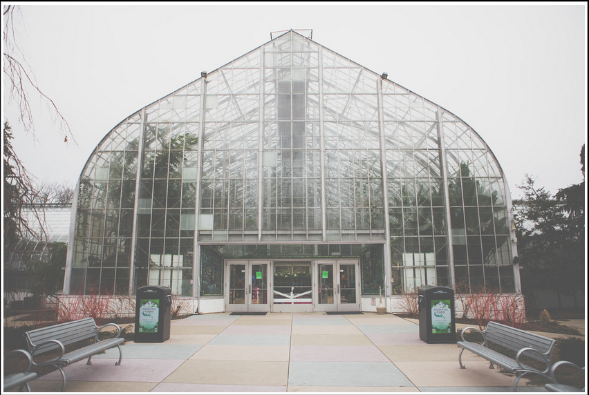 The entrance to Cincinnati's dramatic, Art Deco Krohn Conservatory captured by photographer Bryon Black. Click through to see more of the charming wedding he captured.