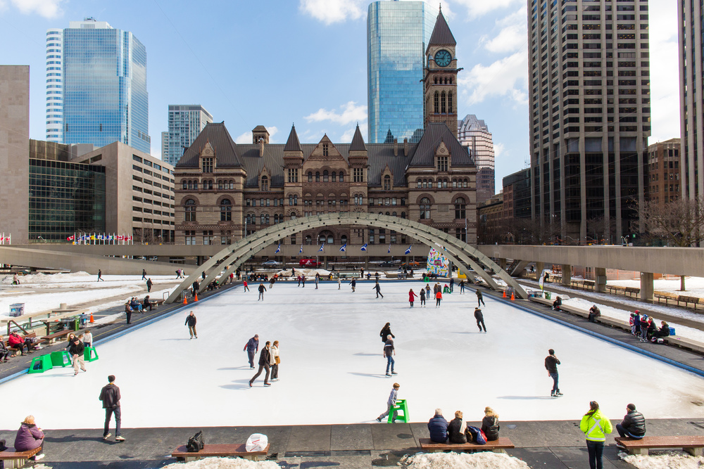 Torontonians getting their last skate in at Nathan Phillips Square.