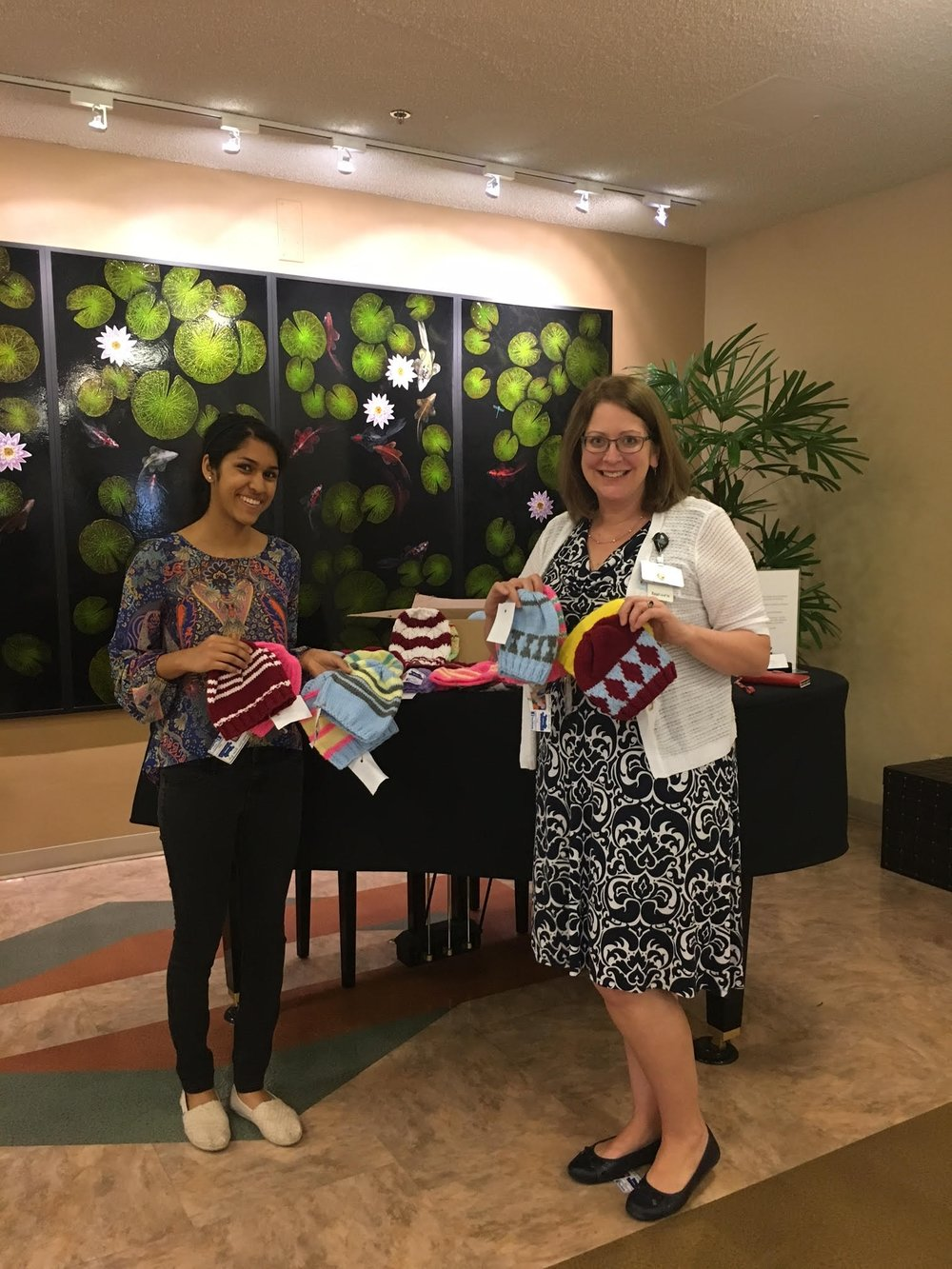 Nikita Salunke making a donation to Ms. Susan Lauer, Director of Volunteer Services, Good Samaritan Hospital