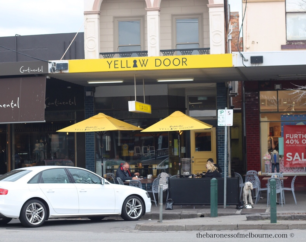Yellow Door stands out in the clusterof Albert Park cafes