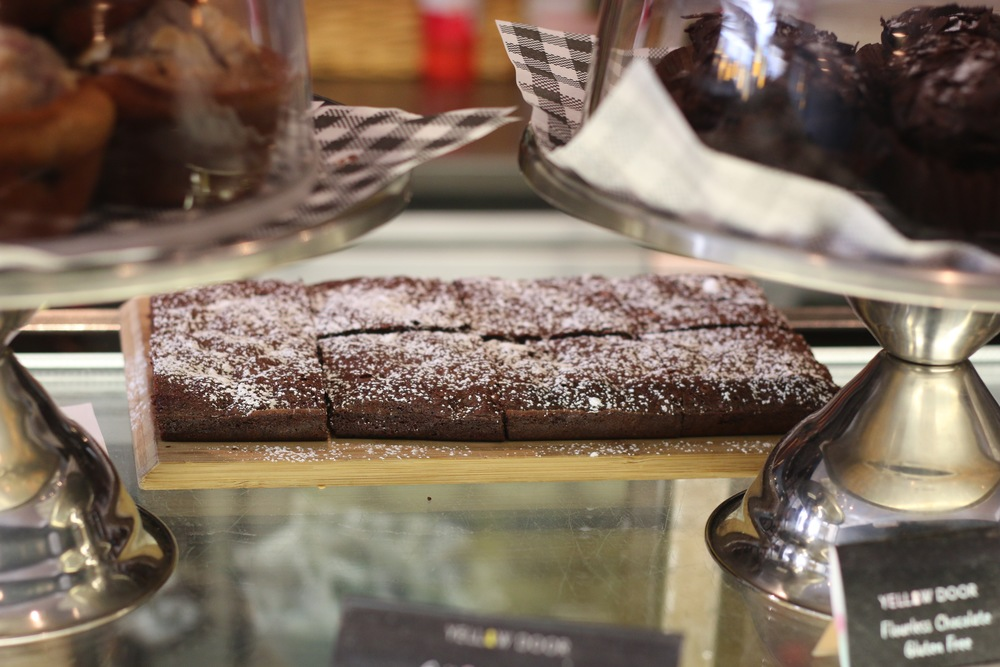 Some sneaky chocolate brownie attempting to hide at Yellow Door cafe