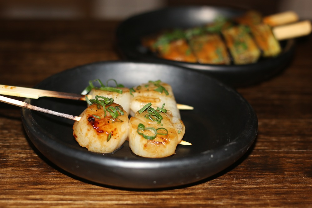 Scallop yakitori with a photo bomb by eggplant yakitori