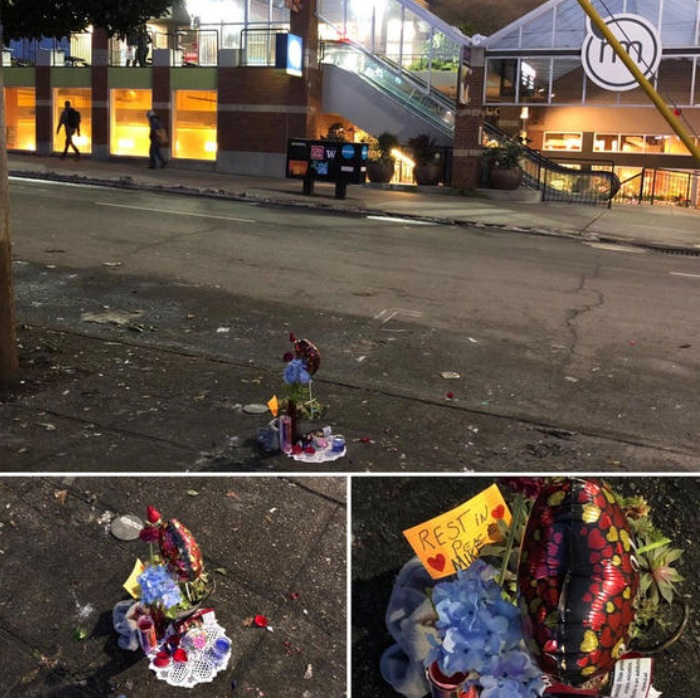 The photos show what appears to be a remembrance of Michael, the sidewalk camper who was originally at 528 Queen Anne Ave North and more recently at 600 1st Ave North, opposite Metro Market in the Lower Queen Anne/Uptown neighborhood of Seattle, WA, USA. There is conflicting information about his status and he may still be alive in an area hospital recovering from frostbite.