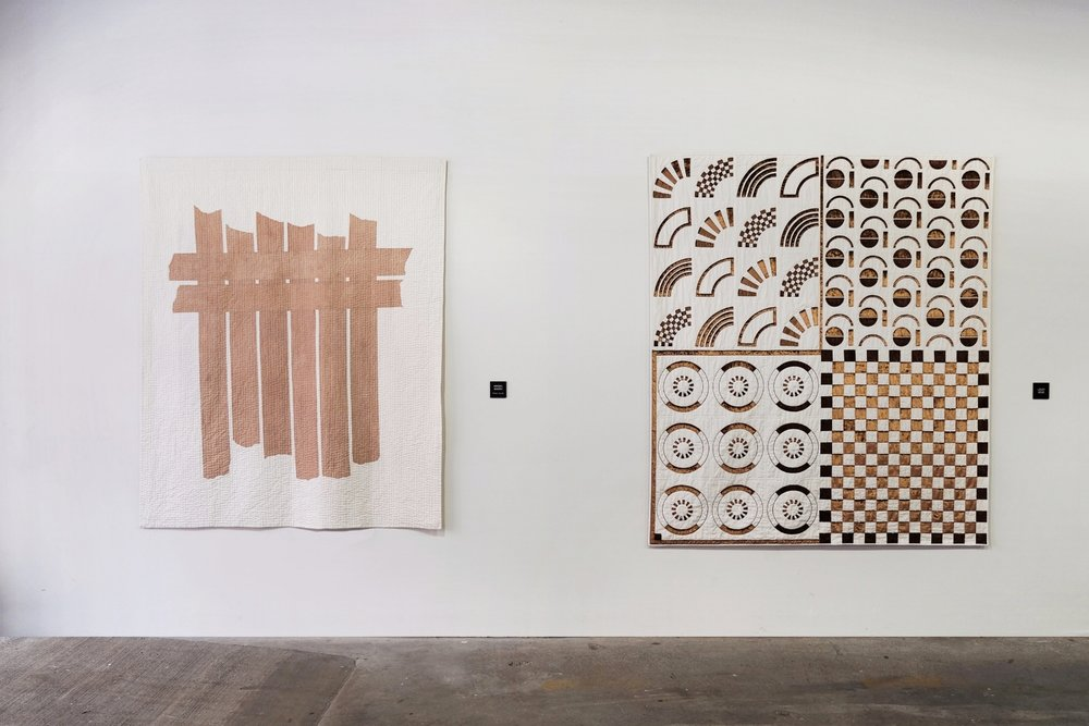 Blushed Bars (left)  | wood tannin on cotton | 172cm x 205cm | 2017   Copper Quilt (right)  by Lesley Gold   Installation View, Piecework Collective, New York