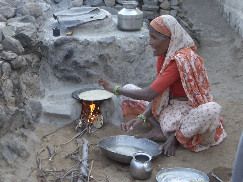 Cooking chapathi on an outdoor stove