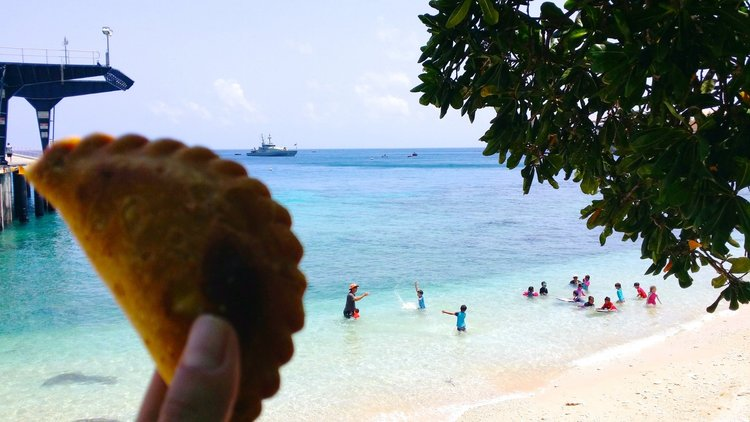 Malaysian curry puffs beside the reef