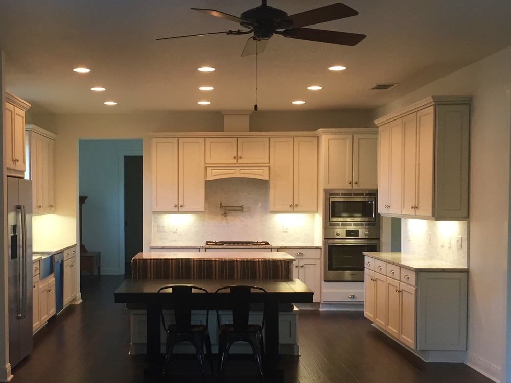 Kitchen includes granite counter tops, and designer cabinets