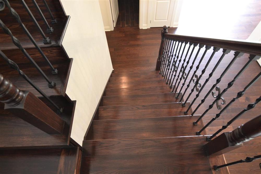 Solid wood staircase leading to second floor