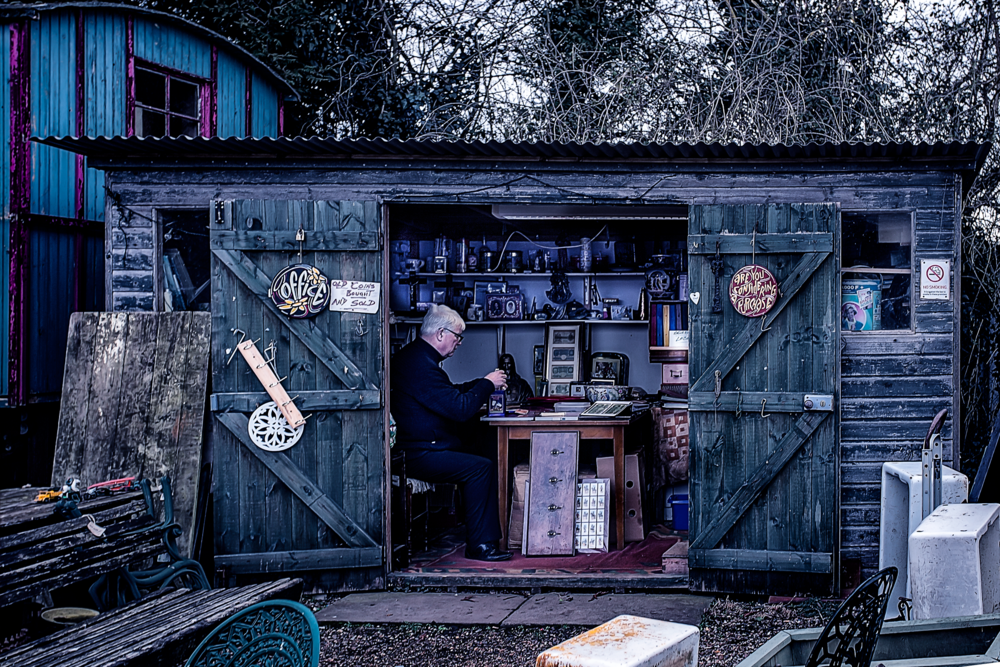 Man-at-work.--Antiques-Centre,-Essex..png