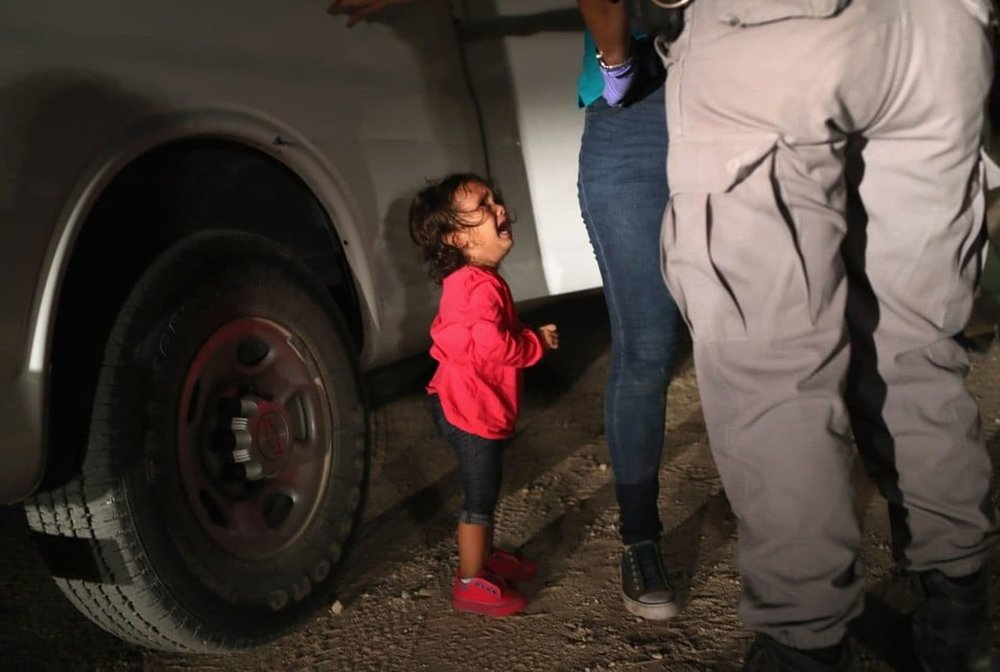 A two-year-old Honduran asylum seeker cries as her mother is searched and detained near the U.S.-Mexico border on June 12, 2018 in McAllen, Texas. (Photo: John Moore, Getty Images)