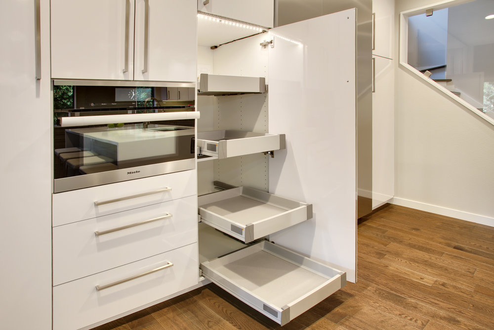 LED Lighting inside pantry cabinets with roll-out shelving makes for great storage that you can see!