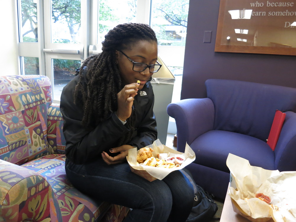 Brandi having a taste of the Fish and Chips