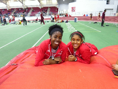 Maya and I relaxing on the high jump mats after our races