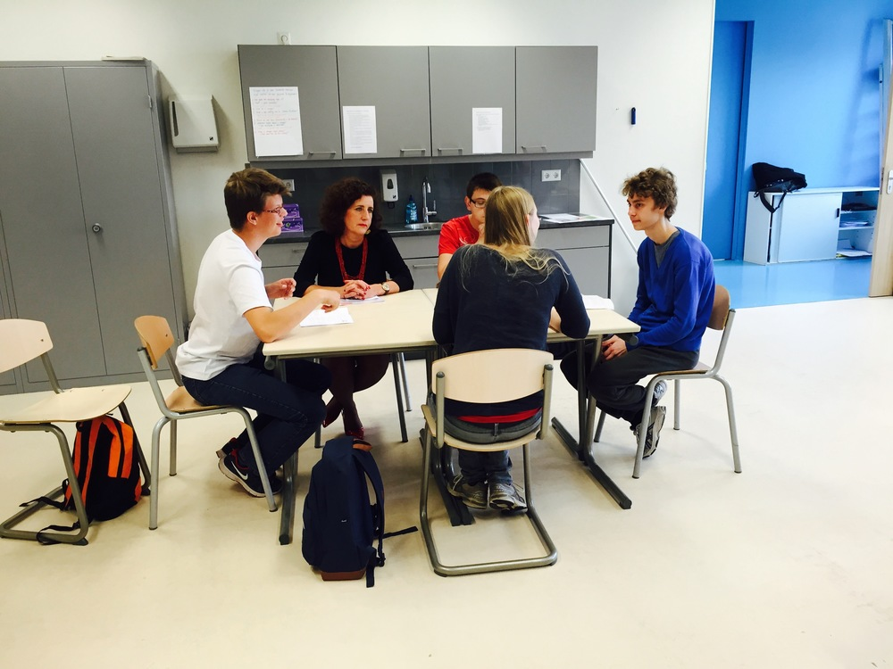 Small-group tutoring at the College St. Paul, joined by Hague Deputy Major Ingrid van Engelshoven.