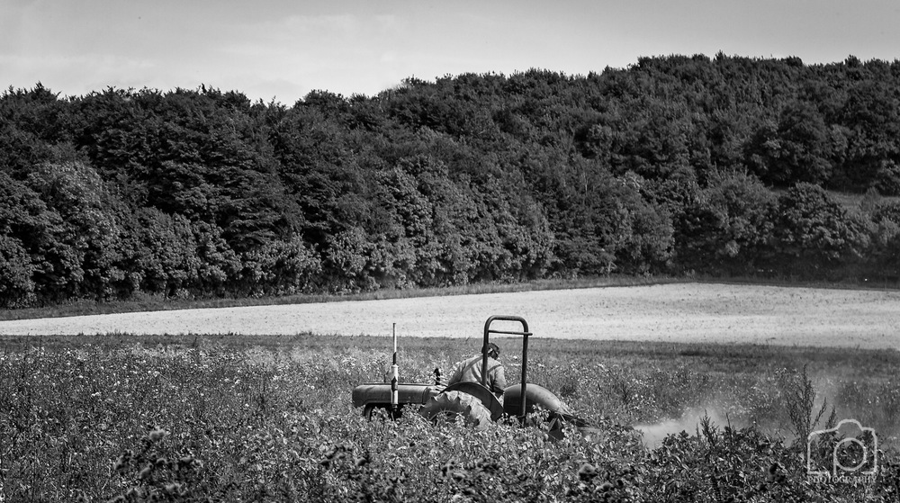 Farmer at Work on a Tractor
