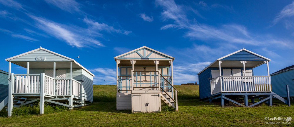 Blue and White Beach Huts