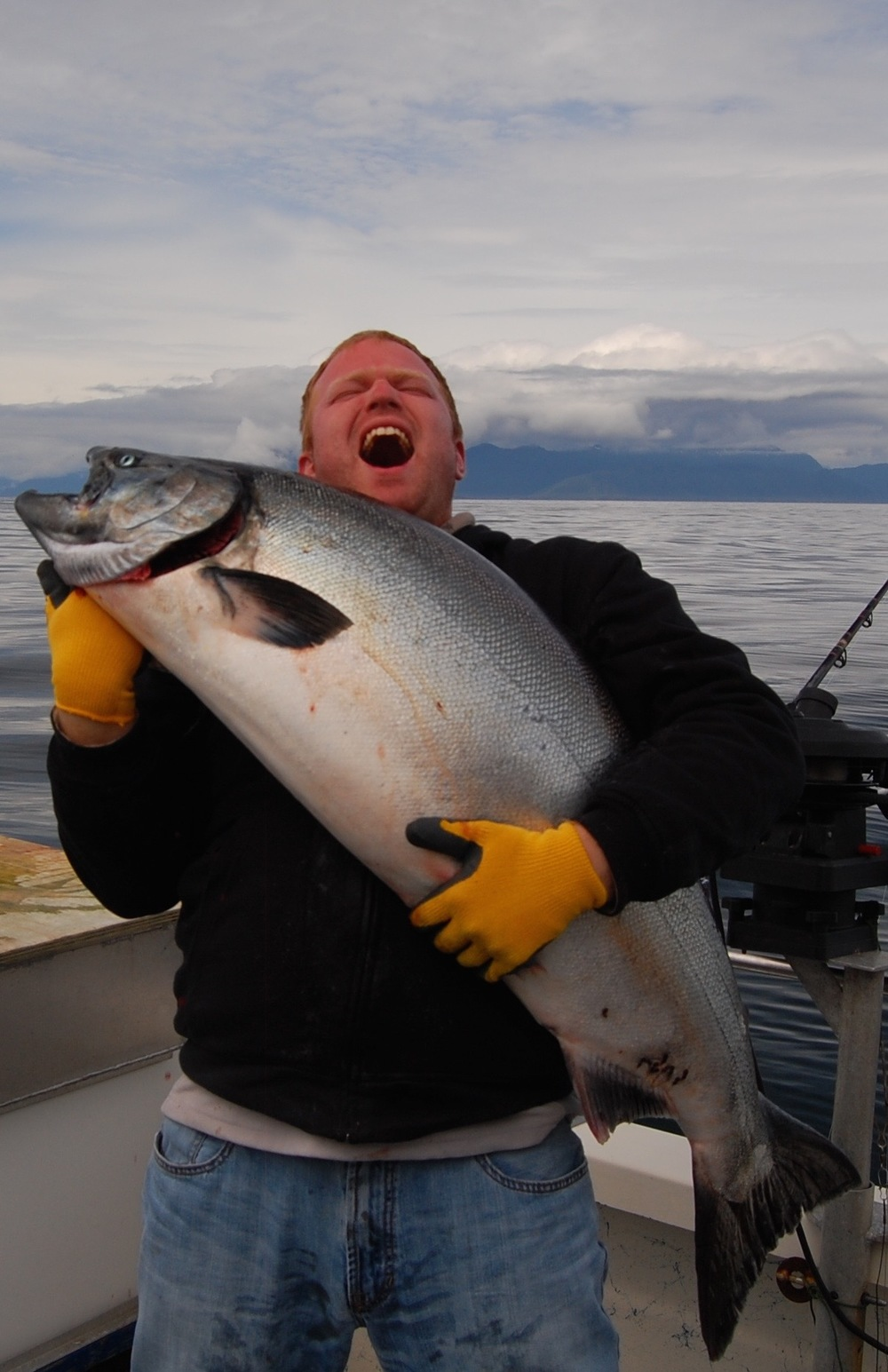A guest cannot control his excitement after he caught this monster salmon!