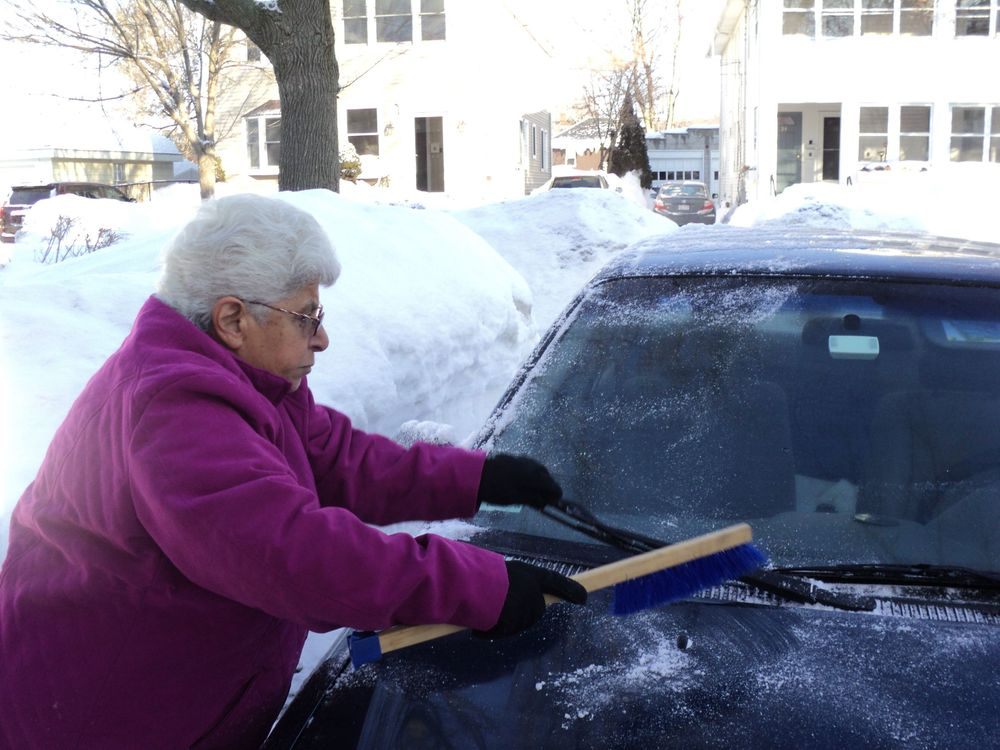 Joan cleaning the car.jpg