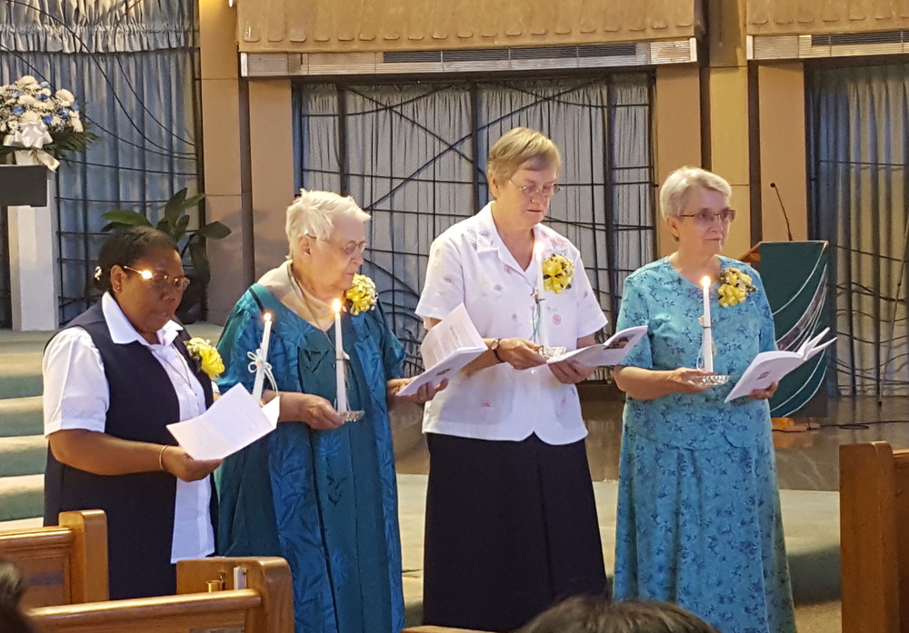 Sister Cecilia Legani (25th jubilee) and Sisters Miriam Cripps, Cornelia Fitzpatrick, and Virginia Fornasa (50th Jubilee) renew their vows.