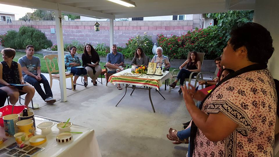 Sisters Pesio Iosefo (right) and Mary Jane Kenney (center) prepare a group in San Bernardino, CA to travel to France for the Bicentennial celebration.