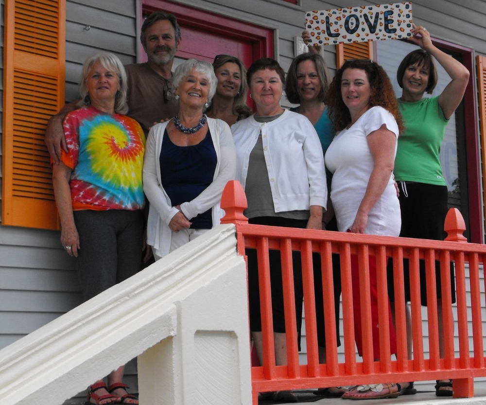 Front row: Linda Mills (owner, E500RYT, instructor, Yoga Therapist), GiGi (sub teacher), Laura Mallernee (mindfulness facilitator), Lori Miles, Patt Dillin (Holistic Nutrition); Back row: Brian Hallgren (200 RYT, instructor), Anna Hornsby (200 RYT, instructor), Dawn Spiegl (special events). Not in picture: Lindy Murff (instructor, specializing in Hula Hooping-really!)