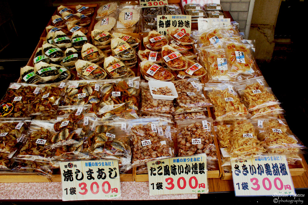 Picking up some octopus shavings to snack on while I explore the Tsukiji FIsh Market
