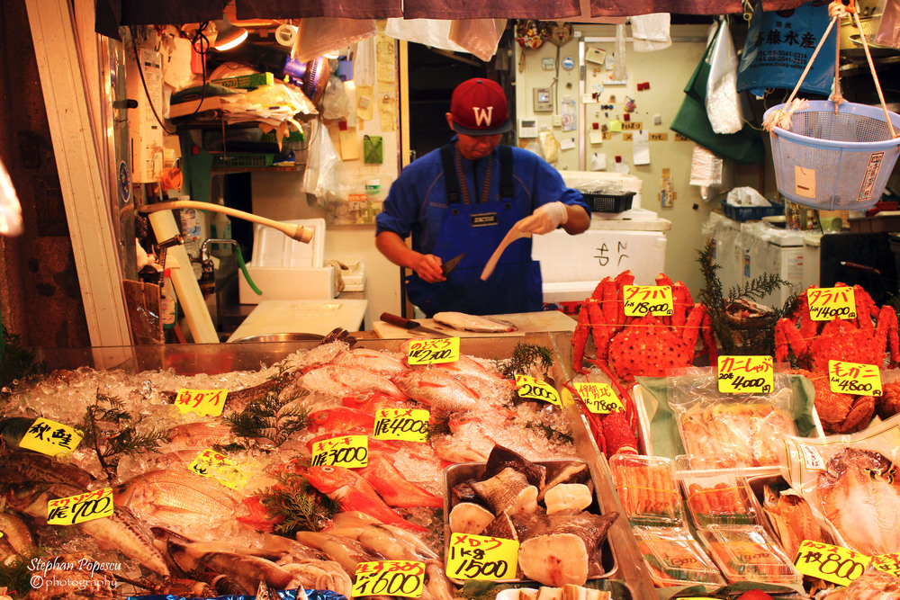 Selling some of day's fresh catches after the Tsukiji Fish Market auction has ended