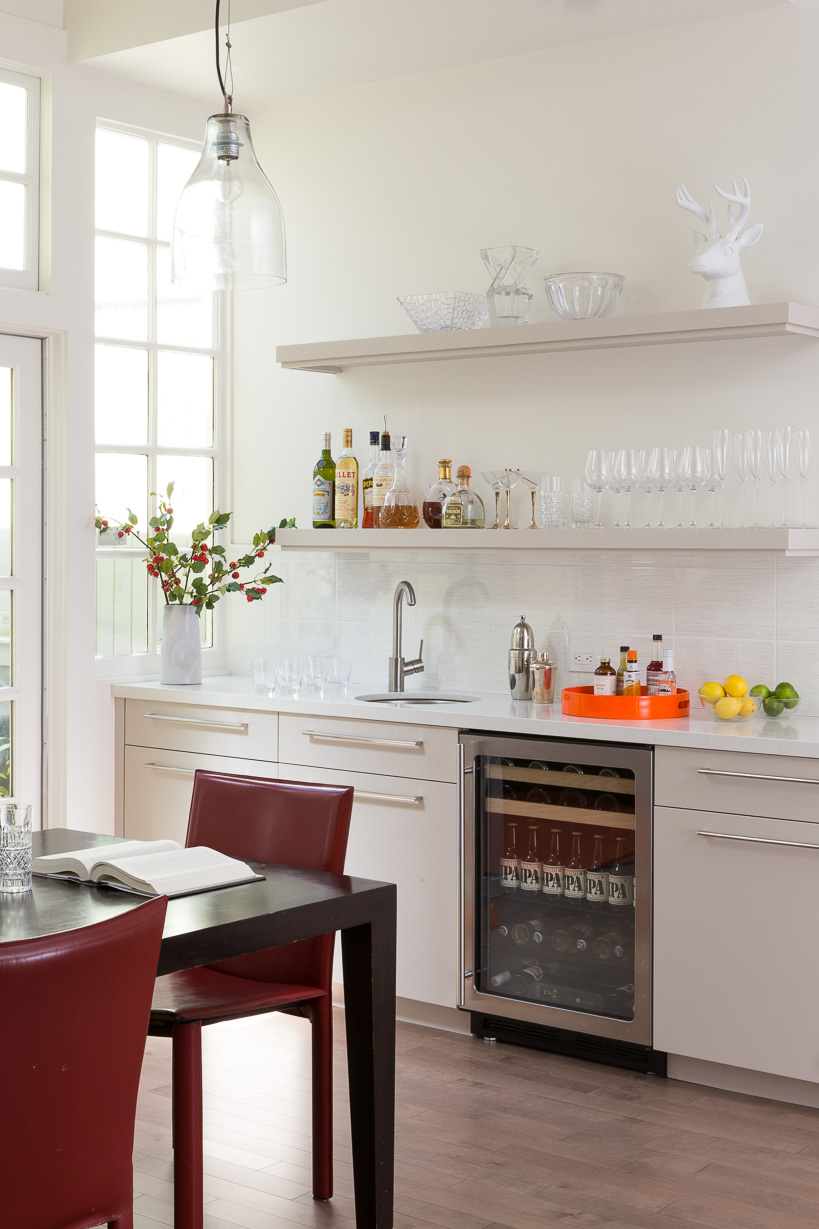 A separate bar for him is perfect for entertaining and provides space for mixology concoctions.
