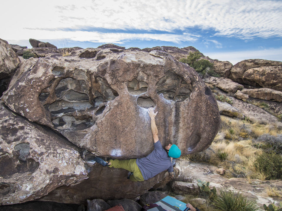 Bouldering At Hueco Tanks State Park in Texas  | Hueco Tanks State Park is one of those climbing destinations that if you enjoy bouldering should be high on your list of places to climb at. It won't be easy climbing and it is guaranteed to challenge you and make you work for it, but if you're lucky you'll get a send in one of the most epic bouldering locations in the United States. There are some regulations for taking a trip there due to all the old rock art that can be found in the area, but I've detailed everything you need to know in our post. | shedreamsofalpine.com