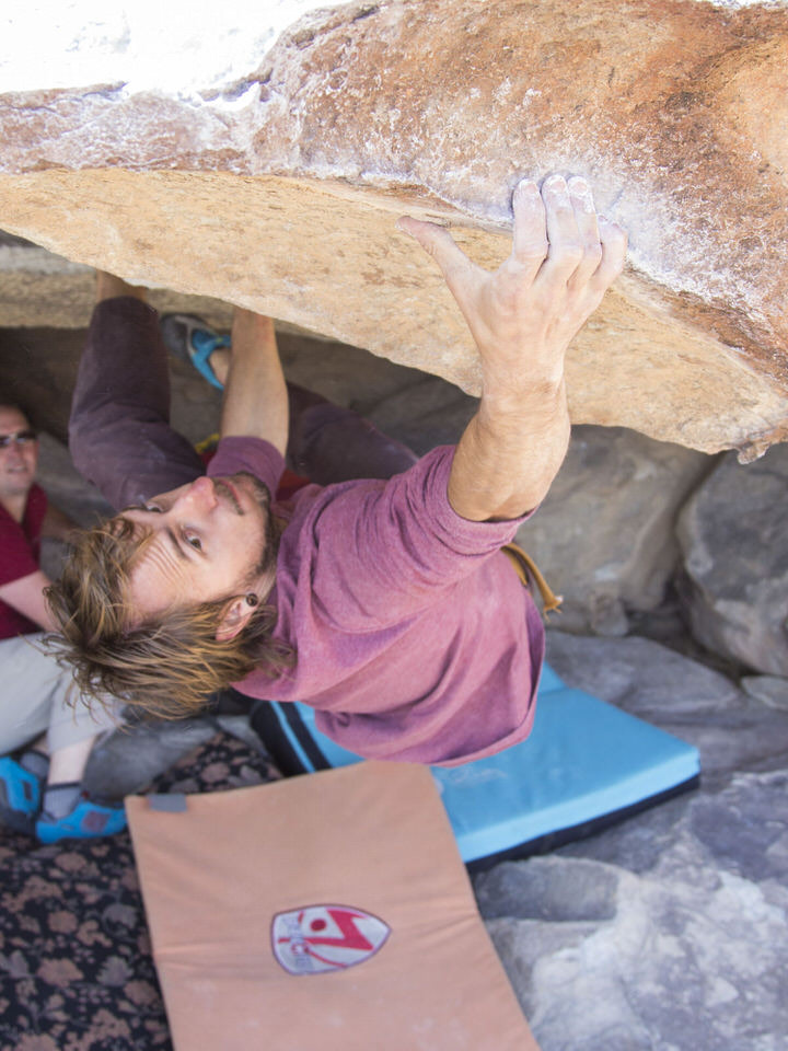man-climbing-at-hueco-tanks
