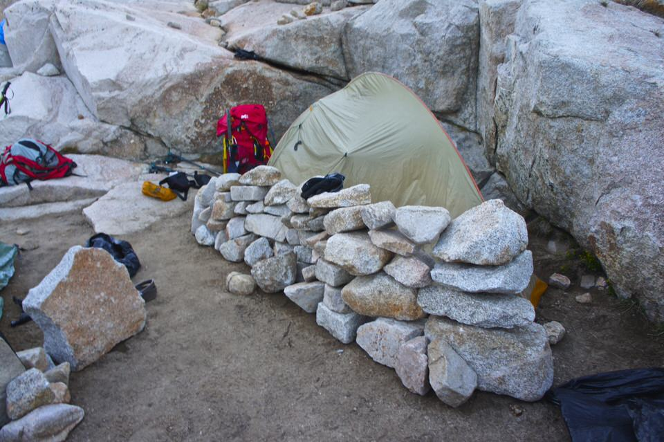 tent-surrounded-by-rock-wall