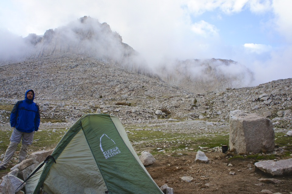 man-and-tent-at-base-of-mount-whitney-by-guitar-lake