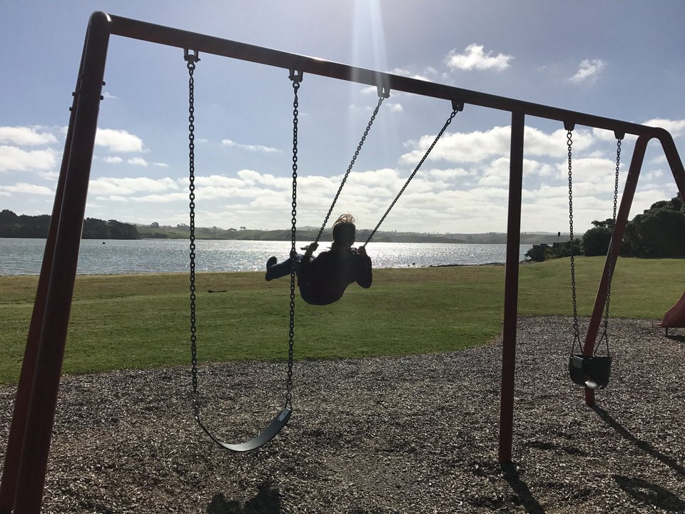 girl-on-swing-set-clarks-beach-holiday-park