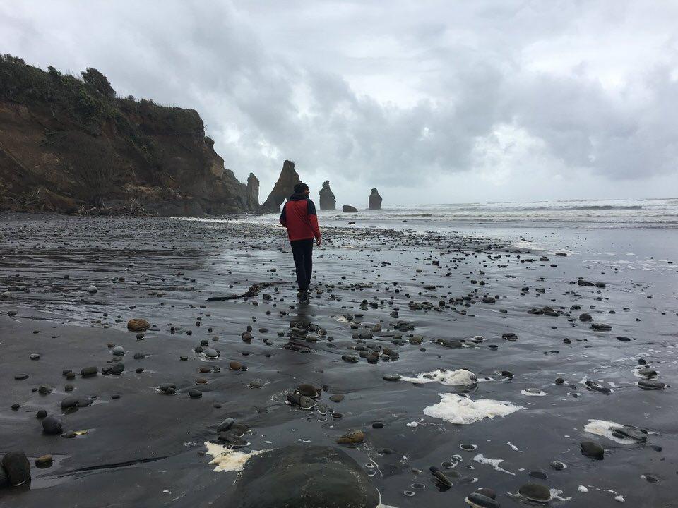 man-walking-tongaporutu-new-zealand-north-island