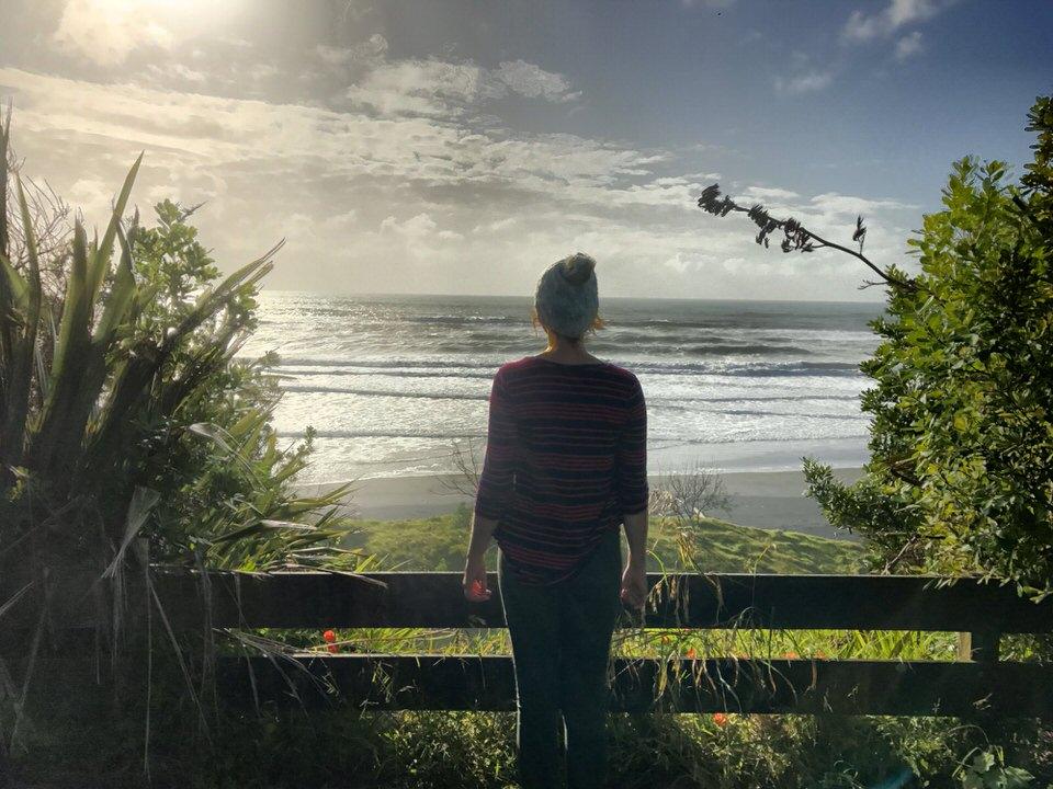 woman-looking-at-ocean-Mokau-new-zealand-north-island