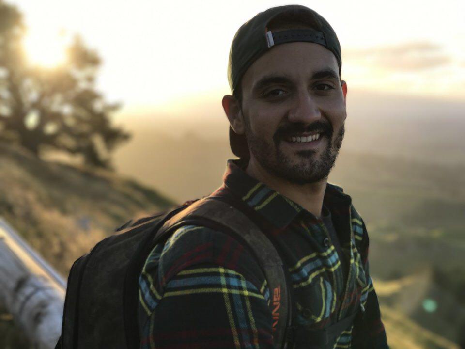 man-smiling-mata-peak-new-zealand-north-island