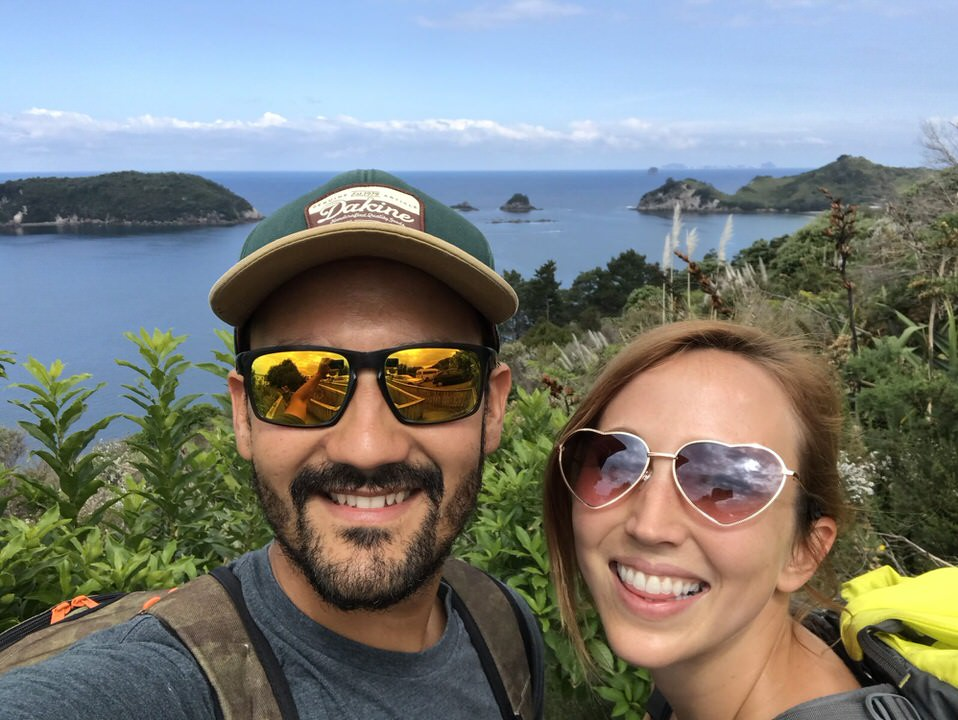 couple-at-cathedral-cove-new-zealand-north-island