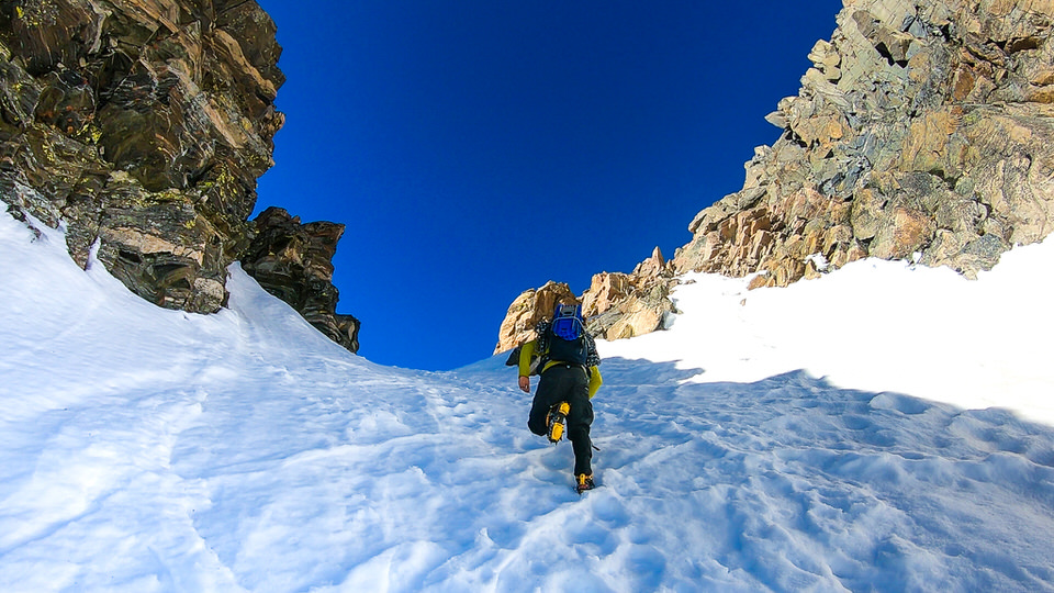 Snow climbing with crampons