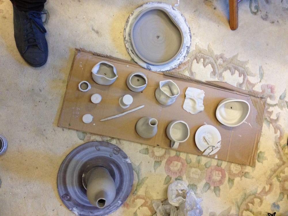 Clay tableware about to start baking. I think the broken ash tray and the wine bottle turned out especially well.