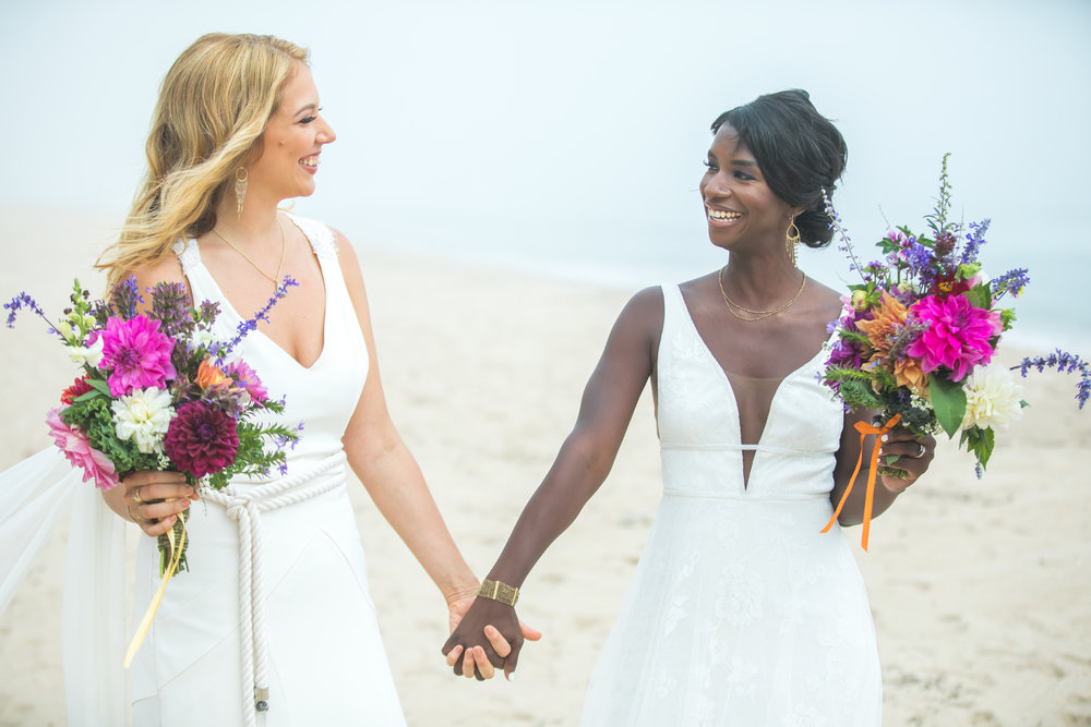 KAROLINE + DIEDRA                                         TIED THE KNOT: September 16th, 2017         VENUE: Private Residence, Montauk, NY               OUR FAVORITE PART: The intimate ceremony on the beach in the round  - What They Said: We have nothing but amazing things to say about the entire process with the T&S team. We were getting married at a beach house that had multiple complexities and logistical constraints including 20 vendors, 2 cocktail hours, ceremony on the beach and reception in the backyard, and an after hours lounge back at the beach - top it off with 80 stairs between the house and the beach! T&S handled it all with ease.Once we chose the vendors, T&S managed all communication with them including contracts, updating any new information and delivery info. They are extremely organized and know when to negotiate. We had monthly, then weekly calls leading up to the day, and a detailed timeline that they developed based on our conversations. We and they had deliverables that T&S would track. This was critical for us, and kept us sane - this process alone was worth the cost. They have tons of experience, so they know who to recommend if you decide 8 weeks before your wedding that you want a videographer.They kept on track throughout the day as we were getting ready and through our photography sessions. People say the devil is in the details well they are angels with the details everything from placing our shawls and shoes by our seats after the ceremony waiting for us.We trusted this team with our day and they did not disappoint. By the end of the experience we considered them, our fairy god sisters.