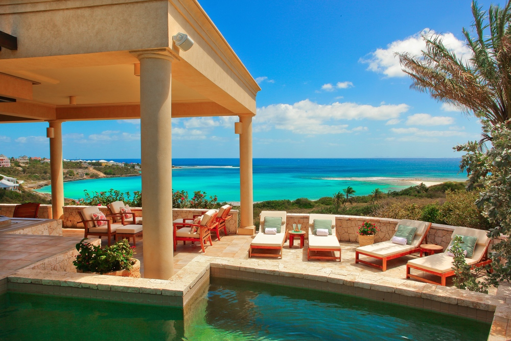 View of Sandy Hill Beach and exterior of Bird of Paradise luxury villa for rent on Anguilla island