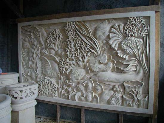Underwater marine scene carved for a hallway. Planters to the left also hand-carved for the owners. Photo taken in Bali.